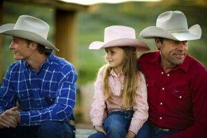 Cowboys mit Mädchen auf der La Reata Ranch