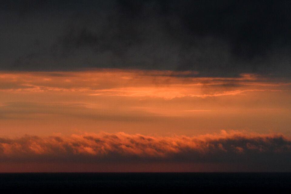 Die Belohnung fürs Warten im Nebel: Sonnenuntergangsfarben im Bellsund